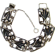 Old Arts and Crafts Era Link Bracelet Sterling Silver Handwrought Stylized Floral Lily Design