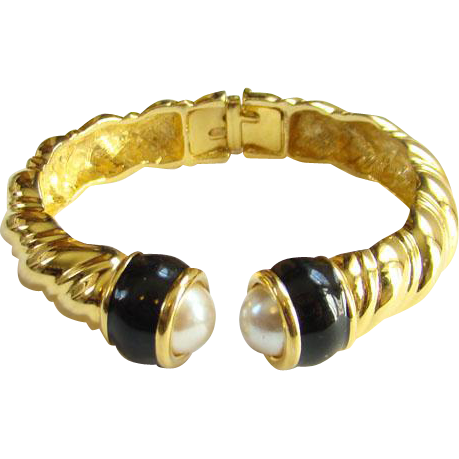1995 Joan Rivers Hinged Gold Tone Bracelet Black Enamel Screw End Caps Book Piece
