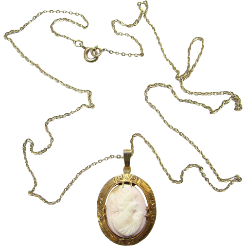 Antique Hand Carved Pink Conch Shell Cameo Pendant Necklace Decorated Gold Plated Frame
