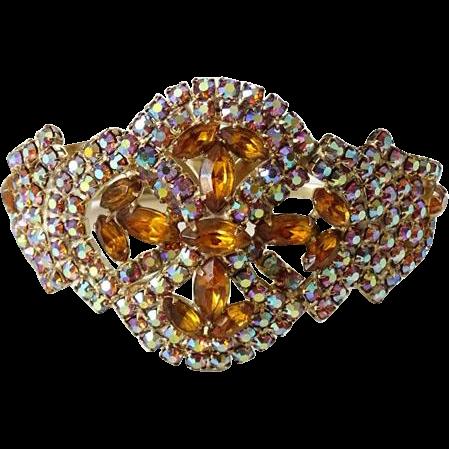 Vintage 1960s Amber and Blue Aurora Borealis Rhinestone Clamper Bracelet Goldtone Encrusted