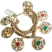 Yves Saint Laurent Gilt Medallion Charm Bracelet. 1980's.