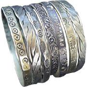 Wonderful Stack of Seven Mexican Sterling Bangles. 1960's.