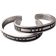 "Pair of Kenneth Begay Navajo Modernist Sterling Silver ""White Hogan"" Cuff Bracelets"