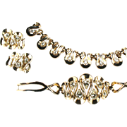 Trifari Swirl Crystal Rhinestone Necklace, Bracelet and Earrings