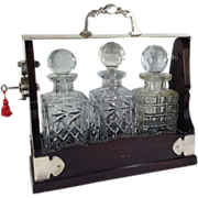 English Victorian Mahogany Tantalus with Three Glass Bottles & Key