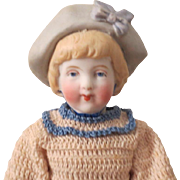 All bisque girl with molded hat. (on consignment)
