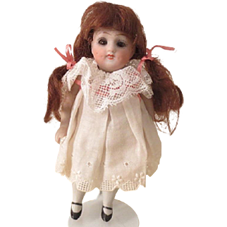 "All bisque girl - 5"", sleep eyes, on consignment"