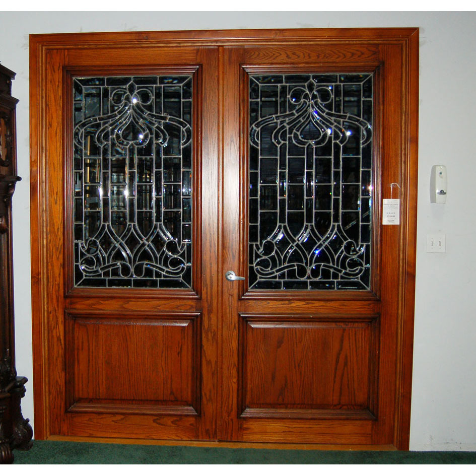 10524 Pair of Antique Leaded and Beveled Glass Panels inset in Oak Doors with Raised Panels