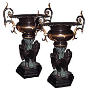 2606 Pair of Large Bronze Urns with Three Herons at Base