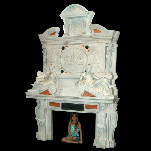 71.4753 Monumental Carved Figural Fireplace