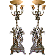 5833 Fabulous Pair of 9'H Silver over Bronze Torcheres