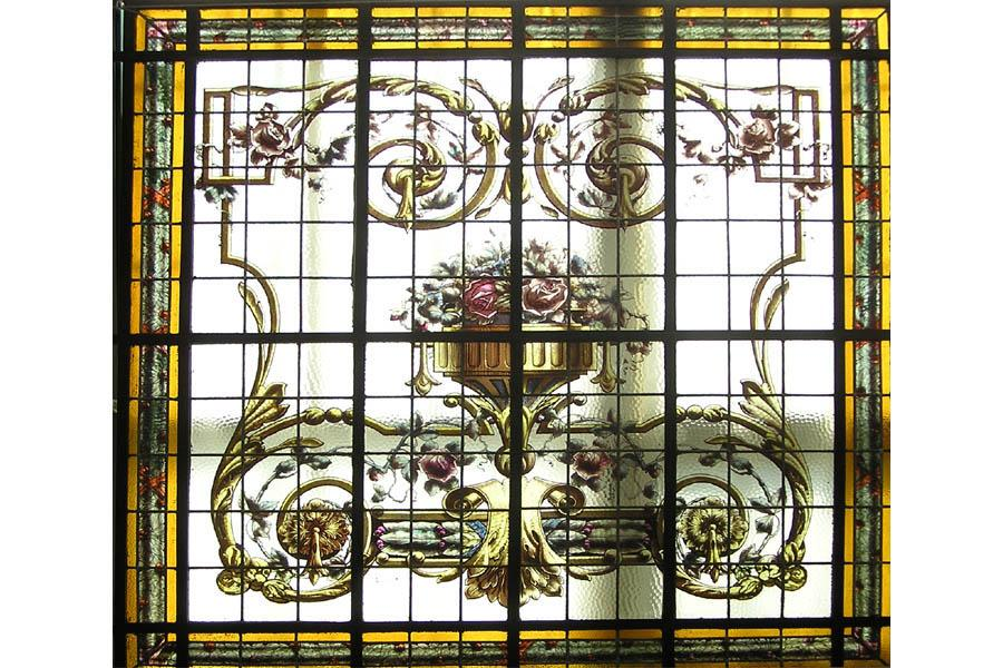 6409 One of a pair of hand painted and leaded glass windows c. 1920.