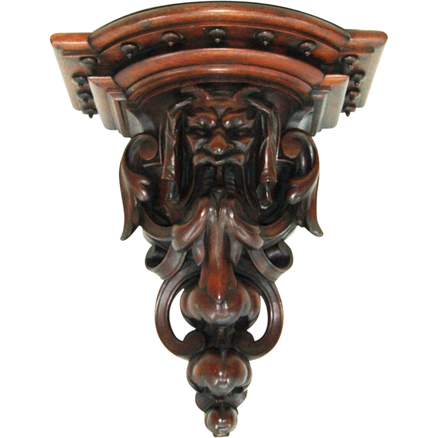 7757 Antique Walnut Gargoyle English Wall Sconce, Heavily Carved, With Scrolling Details around Central Carved Head Below Double Stepped Shelf
