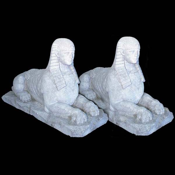 8314 Pair of exceptional hand carved limestone sphinxes signed and dated 1885.