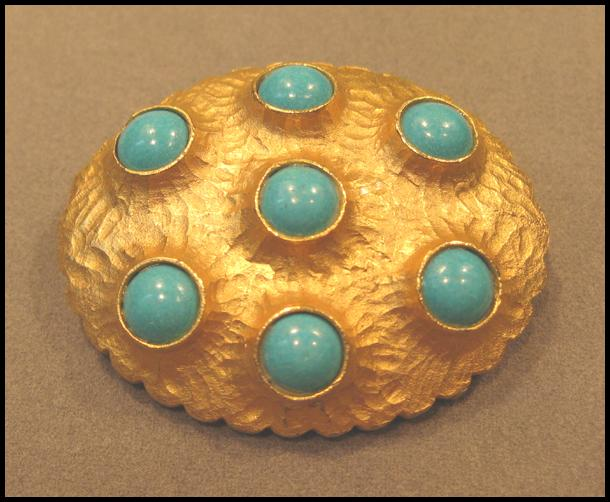 Striking Schrager Brooch with Turquoise Colored Stones