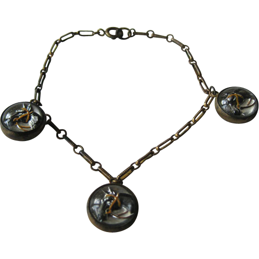 Bracelet with Three Paperweight  Double Sided Reverse Carved Horses Heads