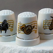 Three Porcelain Thimbles With Pictures Depicting Musical Instruments