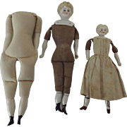 Two China Dolls and a Cloth Body