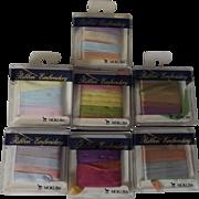 Seven Packages of Variegated Sylk 100% Azlon Ribbon