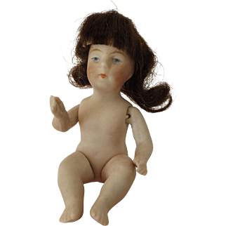Jointed All Bisque Girl In Seated Position