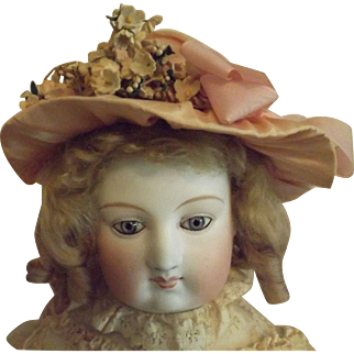 Pretty Pink Bonnet With Flowers