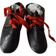Early Shoes for a Large Doll--China, Cloth, Papier Mache