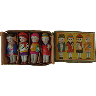 Four All Bisque Dolls in Original Box