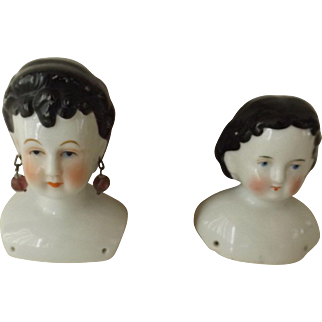 Two China Shoulder Heads, One With Pierced Ears