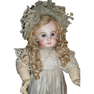 Most beautiful portrait Jumeau french bebe in larger size in spectacular antique couturier clothing