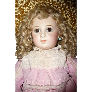 Large first series size 4 almond eyed portrait Jumeau french bebe