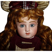 Antique french doll Steiner bebe early in couturier clothing