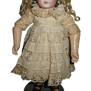 Original antique doll dress in a smaller size very beautiful