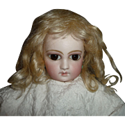 Beautiful small antique mohair doll wig in pale blond with bangs