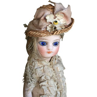 All bisque French mignonette in all original clothing and hat