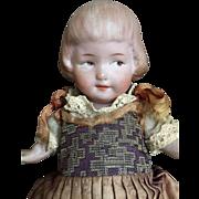 All original all bisque Heubach little girl