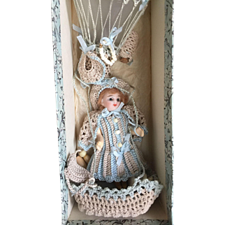 Antique little doll in baloon in box