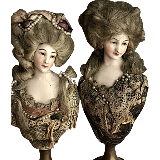 Pair of bisque woman head on bronze base ca. 1900 era