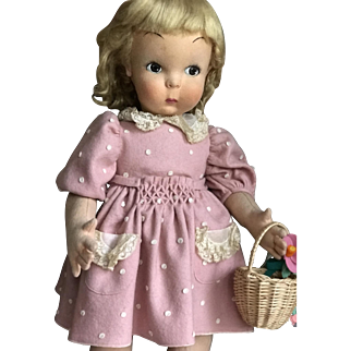 So sweet Lenci doll in all original rose dress with felt dots and flower casket