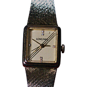 LONGINES  wrist watch 14K gold plated  integral case and bracelet 6 diamonds hours indicators.