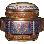 Chinese bronze cloisonne tea storage container with  porcelain top 19th century