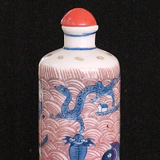 Chinese porcelain snuff bottle hand painted underworld mystical creatures red coral top 6-characters YUNG CHENG 19th century