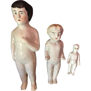 Group of Three Frozen Charlotte Dolls