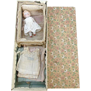 German All Bisque Doll & Wardrobe in Old Box