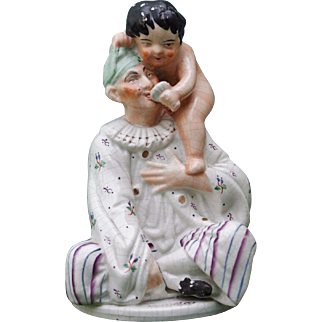 Staffordshire Oriental Man or Pierrot Figure with Cupid
