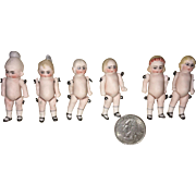 Six Miniature Dollhouse Baby Dolls on Original Card