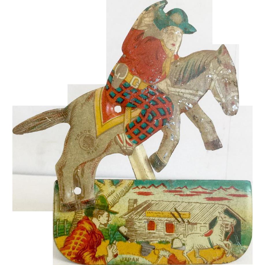 Rare 1940s Tin Cowboy on Horse Clicker Toy