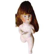 German All Bisque Baby Doll Kneeling