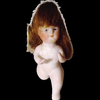 German All Bisque Baby Doll Kneeling