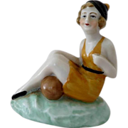 Seated Bathing Beauty with Bud Vase