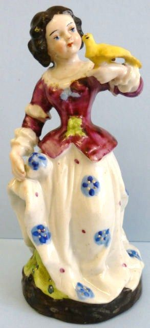 Staffordshire Lady Figurine with Bird